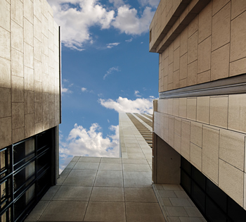 Upward view of concrete buildings and the sky