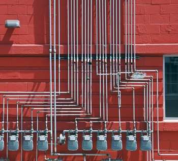 Gas Meters on Red Building Exterior